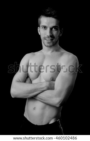 Sportsman posing in black and white