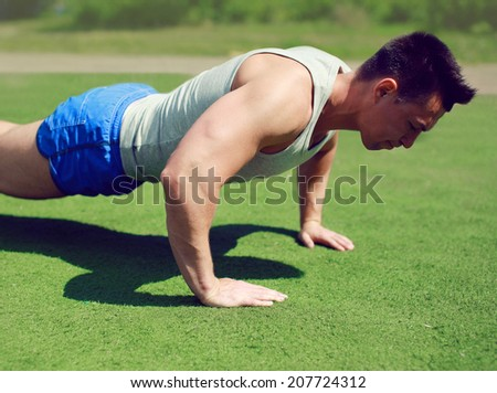 Sportsman push ups outside, fitness, workout, sport - concept - stock photo