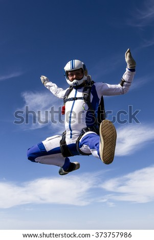 Sportsman skydiver in free style. - stock photo