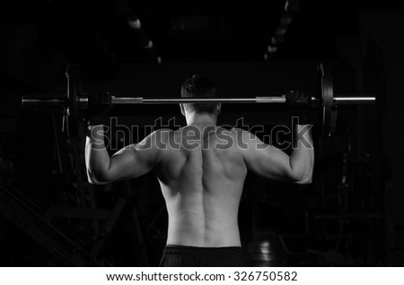 sportsman with a barbell - stock photo