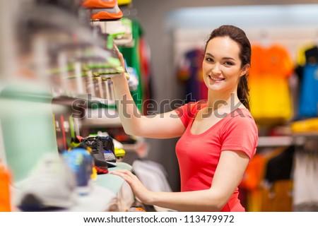 sportswear shop assistant portrait inside store - stock photo