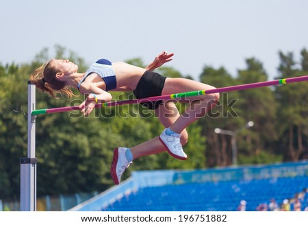 sportswoman jumps in height, sports background - stock photo