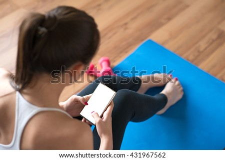 Sportswoman using a mobile phone in the gym. - stock photo