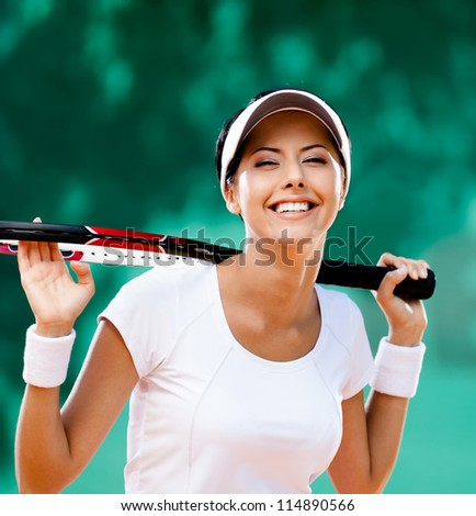 Sportswoman with racquet at the tennis court. Healthy lifestyle - stock photo