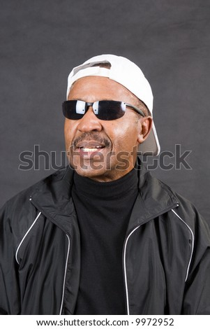 sporty african american man retirement age wearing sunglasses