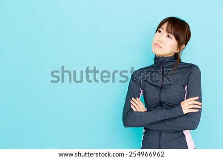 sporty attractive woman on blue background
