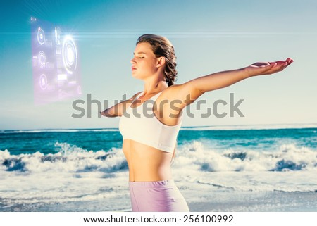 Sporty blonde standing on the beach with arms out against fitness interface - stock photo