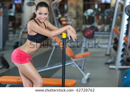 Sporty Girl in fitness hall, healthy concept - stock photo