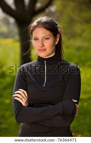 Sporty girl in sportswear standing outside - stock photo