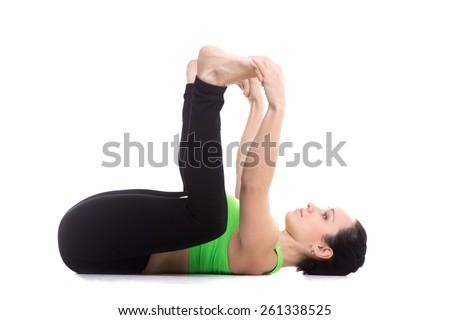 Sporty Girl On White Background Lying In Yoga Happy Baby Pose Ananda Balasana Relaxing