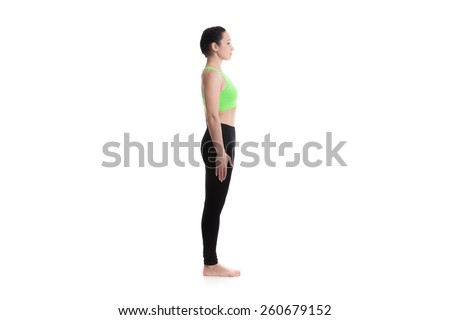 Sporty girl on white background performing basic standing asana tadasana, mountain yoga posture, pose from surya namaskar sequence, sun salutation complex - stock photo
