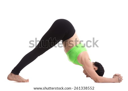 Sporty girl on white background standing in Dolphin Yoga asana, Stretching shoulders, hamstrings, calves, arches, strengthening arms and legs