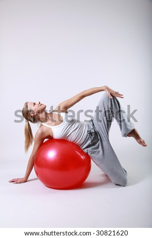 Sporty girl with a fitness ball
