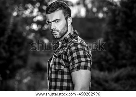 Sporty handsome man in casual clothes poses outdoor.  - stock photo