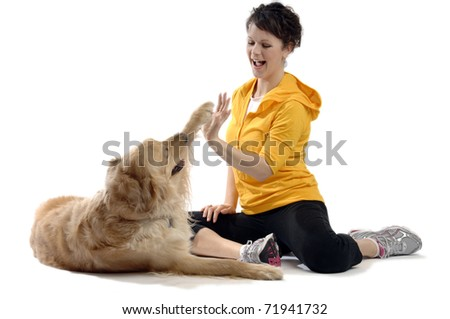 Sporty looking girl plays with her dog.