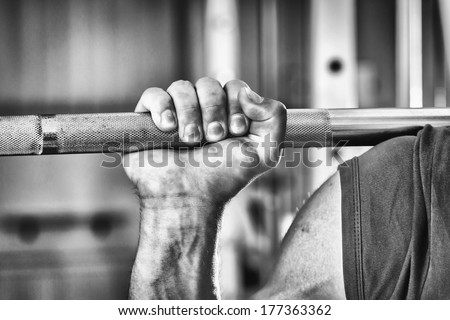 Sporty man doing exercises in gym - stock photo