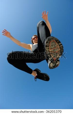 Sporty man jumping - stock photo