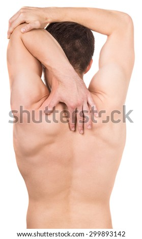 Sporty man suffering from neck pain over white background. Back view.