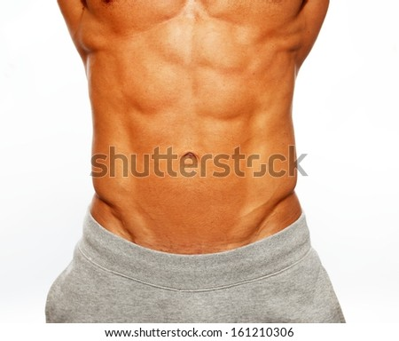 Sporty muscular man showing his abdominals - stock photo
