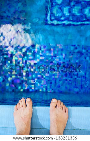 sporty muscular man standing  of the swimming  pool. - stock photo