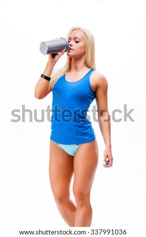 sporty muscular woman drinking water, isolated against white background - stock photo