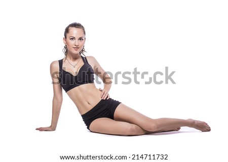 Sporty sexy woman siting on the floor on white background