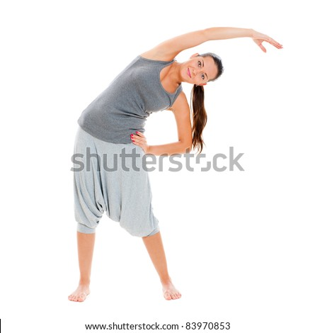 sporty smiley woman in grey sportswear training. isolated on white background - stock photo