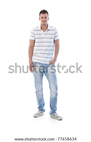 Sporty student smiling in jeans and t-shirt.? - stock photo