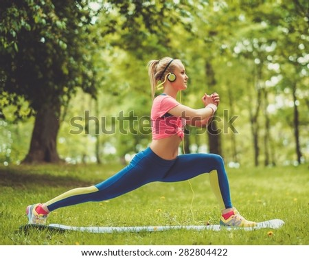 Sporty woman doing fitness exercises outdoors - stock photo