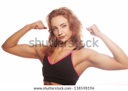 sporty woman is showing her strong hands on gwhite background - stock photo