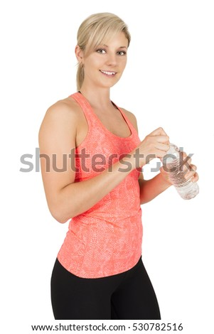 Sporty woman opening bottle of water, isolated on white background