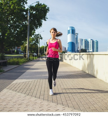 sporty woman running in the city - stock photo