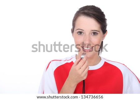 Sporty woman with a whistle - stock photo