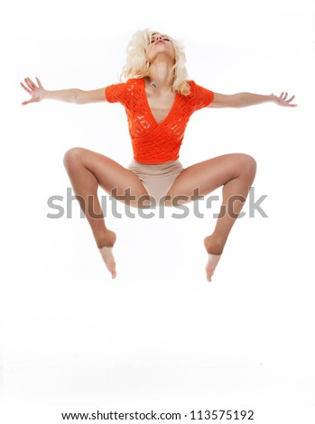 Sporty young fit woman jumping isolated on white background - stock photo