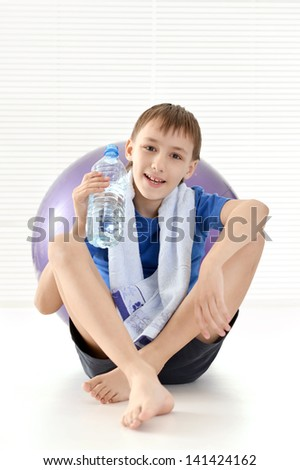 sporty young guy in a blue shirt resting - stock photo