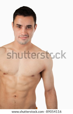 Sporty young male topless against a white background - stock photo