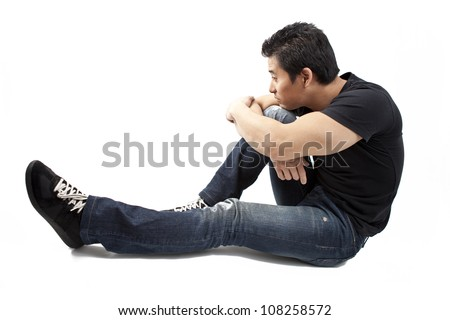 Sporty young man sitting and thinking