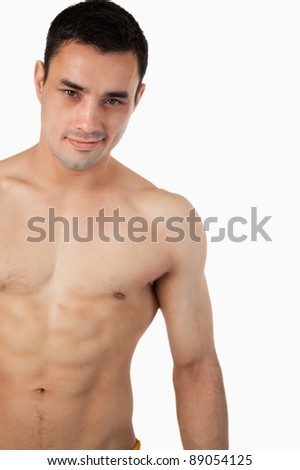Sporty young man topless against a white background - stock photo