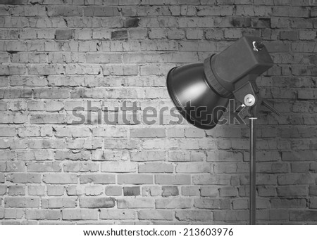 spot light on brick wall - stock photo