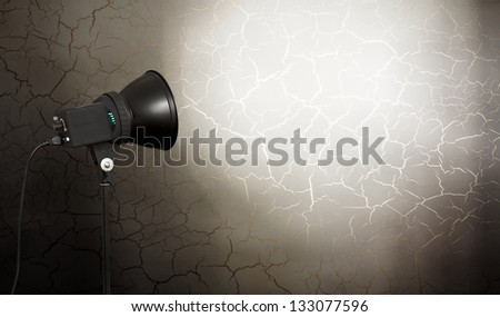 spot light on concrete wall, urban background - stock photo