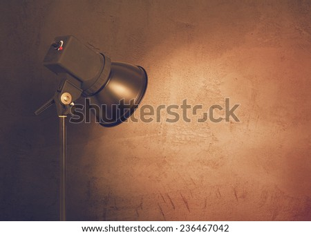 spot light on concrete wall, urban background, retro film filtered, instagram style  - stock photo