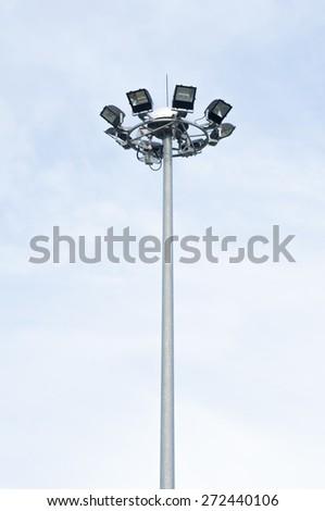 Spot-light tower on blue sky - stock photo