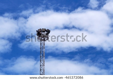 Spot-light tower on blue sky