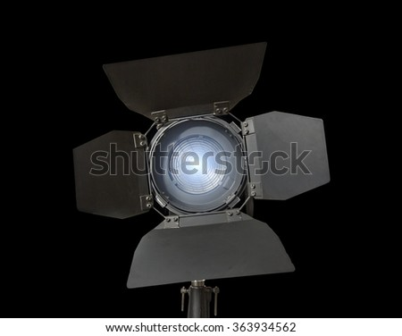 Spotlight fixture glowing used in film and theater productions  isolated on black background - stock photo