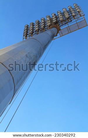 spotlight on blue sky - stock photo