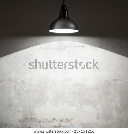 Spotlight on empty wall. - stock photo