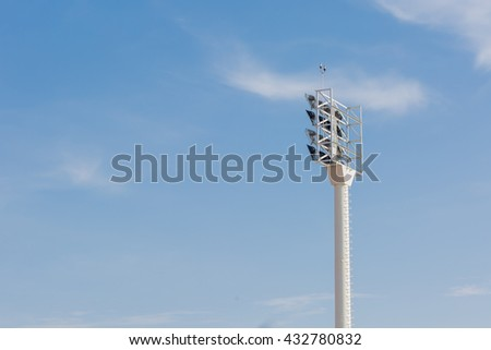Spotlight post on blue sky background - stock photo