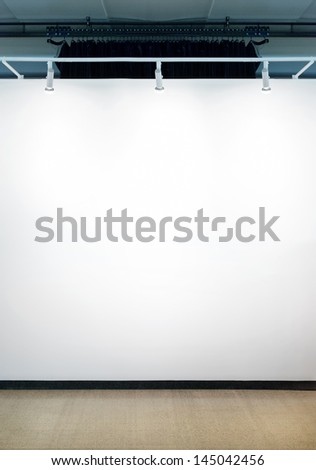 Spotlights on empty white wall. - stock photo