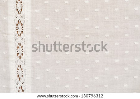 Spotted fabric with a strip of lace - stock photo