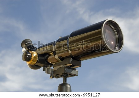 Spotting scope / telescope at daytime, front-side view. - stock photo